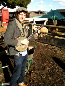 Ed Hicks plays banjo for Spitalfields Music at the city farm