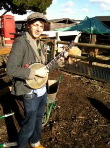 Ed Hicks plays banjo for Spitalfields Music at the city farm